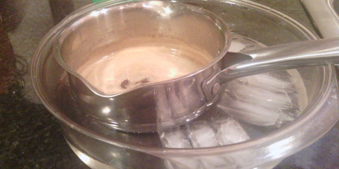 Cooling caramel in ice water