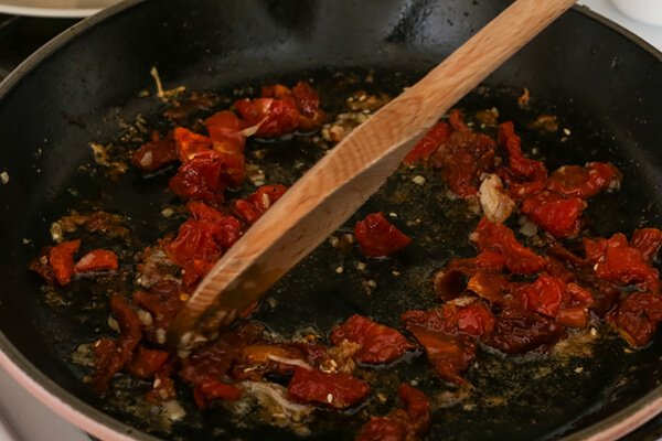 Cooking sun-dried tomatoes.